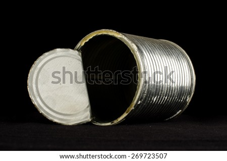 Open tin can isolated on the black background - stock photo
