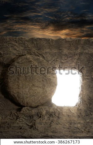 Open tomb of jesus with light coming out of opening - stock photo
