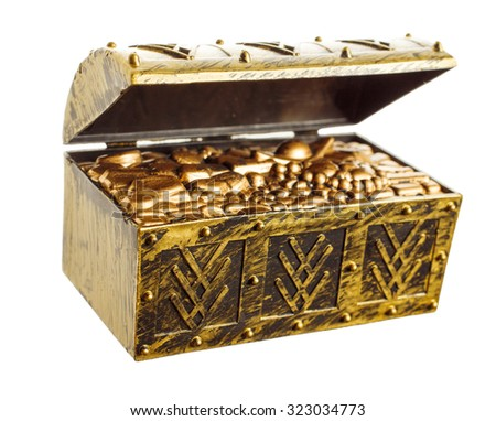 Open treasure chest with shinny gold isolated - stock photo