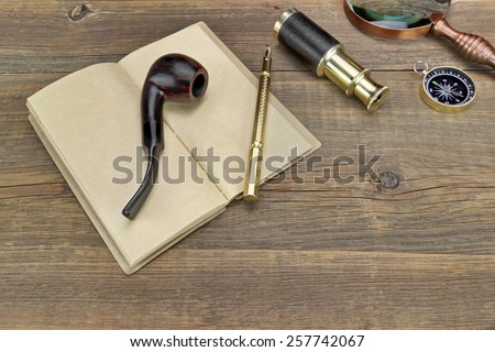 Open Vintage Notebook With Blank Pages, Gold Fountain Pen, Retro Magnifier, Compass and Spyglass On Grunge Wooden Table Background - stock photo