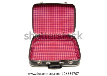 Open vintage suitcase over a white background - stock photo