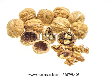 open walnuts closeup in brown pot on sackcloth - stock photo
