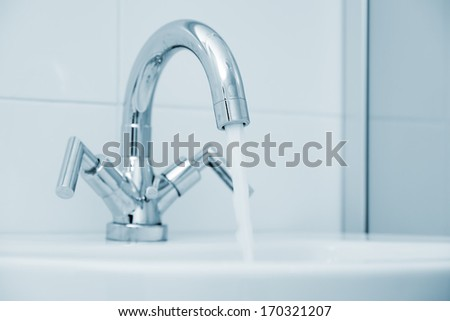 Open water faucet - stock photo