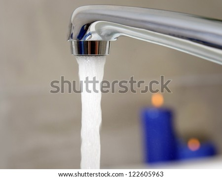open water tap with running water in spa salon - stock photo