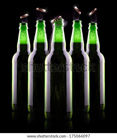 open wet beer bottle isolated on black - stock photo