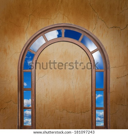 open white door with a view of the sky with the sun sky - stock photo