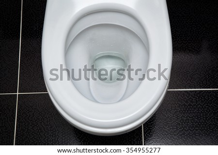 open white toilet top view - stock photo