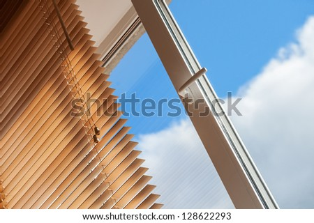 open window and blue sky - stock photo