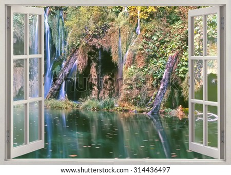 Open window view to deep forest waterfall and pond - stock photo
