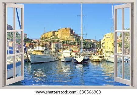 Open window view to Old town Bonifacio, Corsica island - stock photo