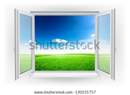 Open window with green field under blue sky on a background - stock photo