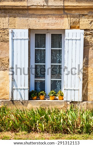 open window with shutters of a typical rustic house, Provence, France, Europe - stock photo