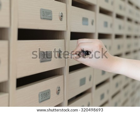 Open wooden mailbox - stock photo