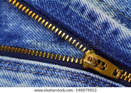 Open zipper of blue jeans - stock photo