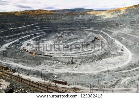 opencast mine excavator and railway - stock photo
