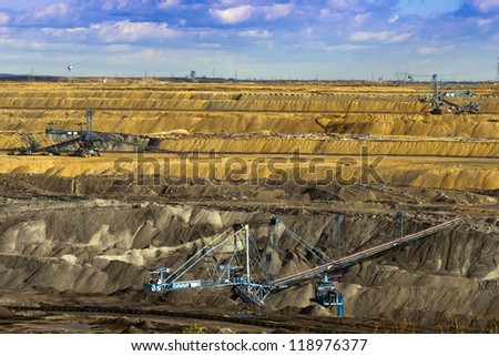 Opencast mine, working machines. - stock photo