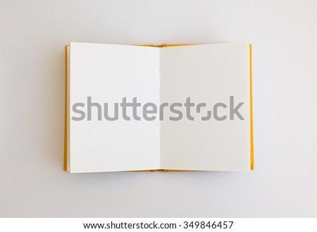 Opened blank notebooks isolated on white background. - stock photo