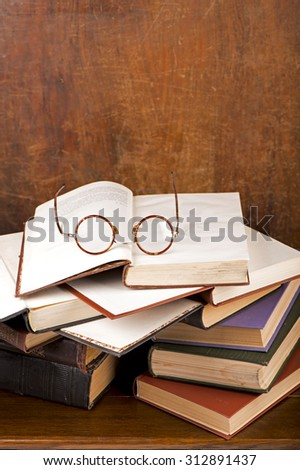 opened book, lying  with a glasses - stock photo