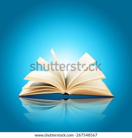 Opened book on bright blue background - stock photo