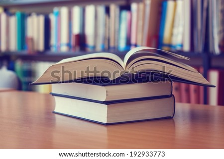 Opened book on the desk - stock photo