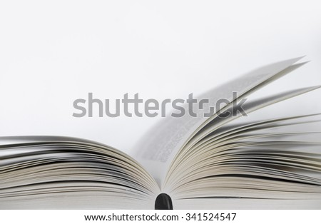Opened book on the table with white background - stock photo