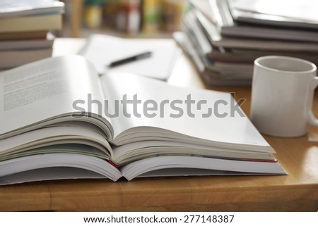 opened book pile put on table - stock photo