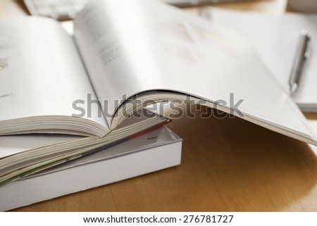 opened book put on table - stock photo