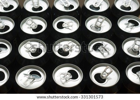 opened canned drinks in black - stock photo