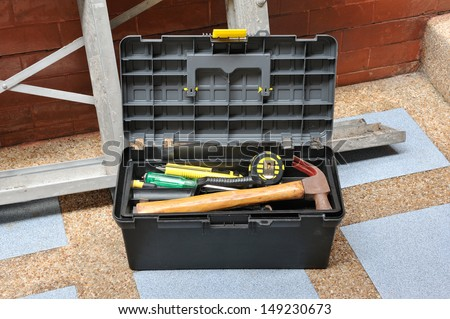 Opened construction toolbox - stock photo