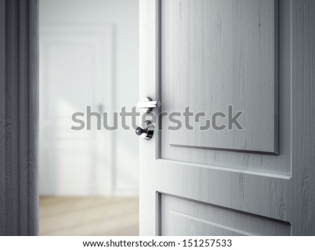 opened door in gray room - stock photo