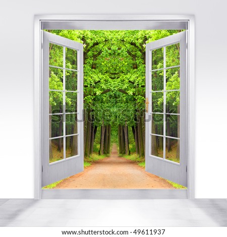 Opened door to early morning in green oak alley - conceptual image - environmental business metaphor. - stock photo