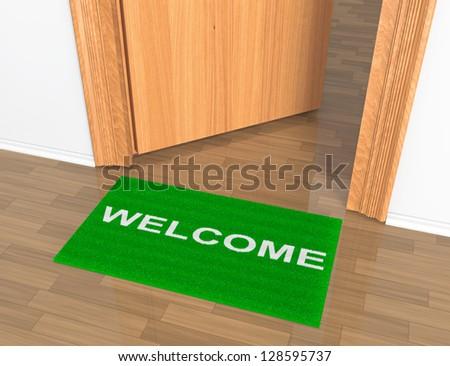 Opened door with welcome rug on the floor - stock photo