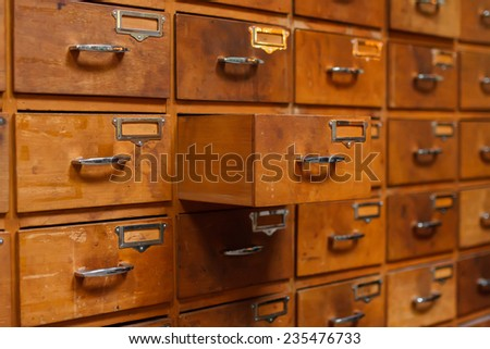 Opened drawer in vintage furniture module. Shallow DOF - stock photo