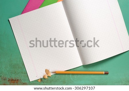 Opened exercise books and pencils on the desk, top view  - stock photo