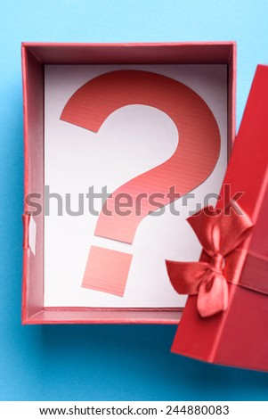 Opened Gift Box With A Question Mark Symbol Inside - stock photo