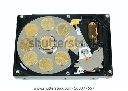 Opened hard disk with israeli coins isolated on white background - stock photo