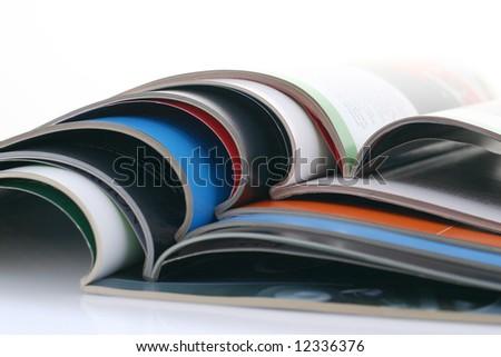 opened magazines - stock photo