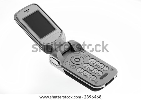 opened mobile phone on white sheet - stock photo