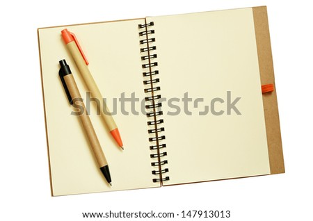 Opened notebook and pens isolated on white - stock photo