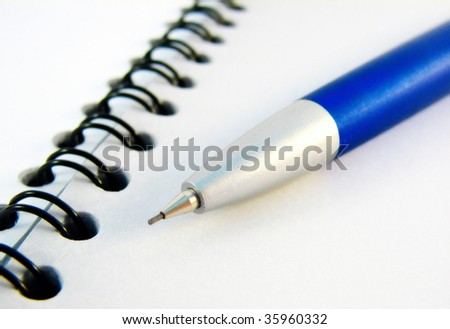 Opened notebook and the pencil - stock photo