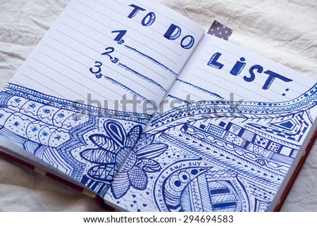 Opened notebook with to do list. Doodle.With shallow depth of field.   - stock photo