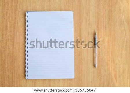 Opened notepad and pen - stock photo