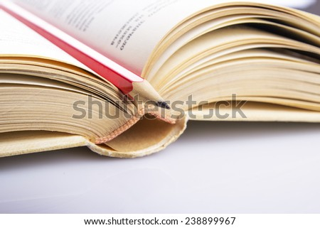 Opened old book with  pencil - stock photo
