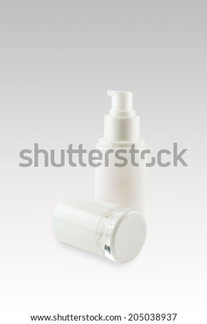 opened out White cosmetics container with lid - stock photo