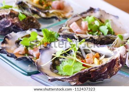 opened oyster food on dish - stock photo