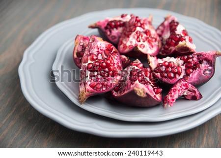 Opened Pomegranate Fruit on Plate - stock photo