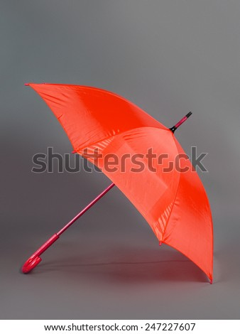 opened red umbrella isolated on gray background - stock photo