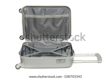 Opened silver suitcase lying on the floor, isolated on white background - stock photo