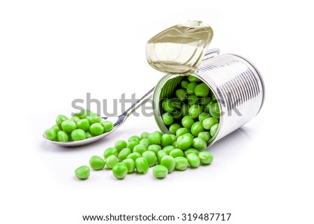 Opened tin with green peas. Isolated on white. - stock photo