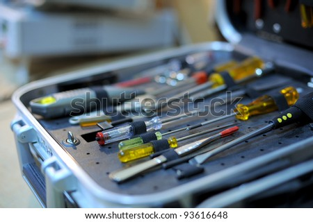 Opened toolbox with screwdriver sets - stock photo